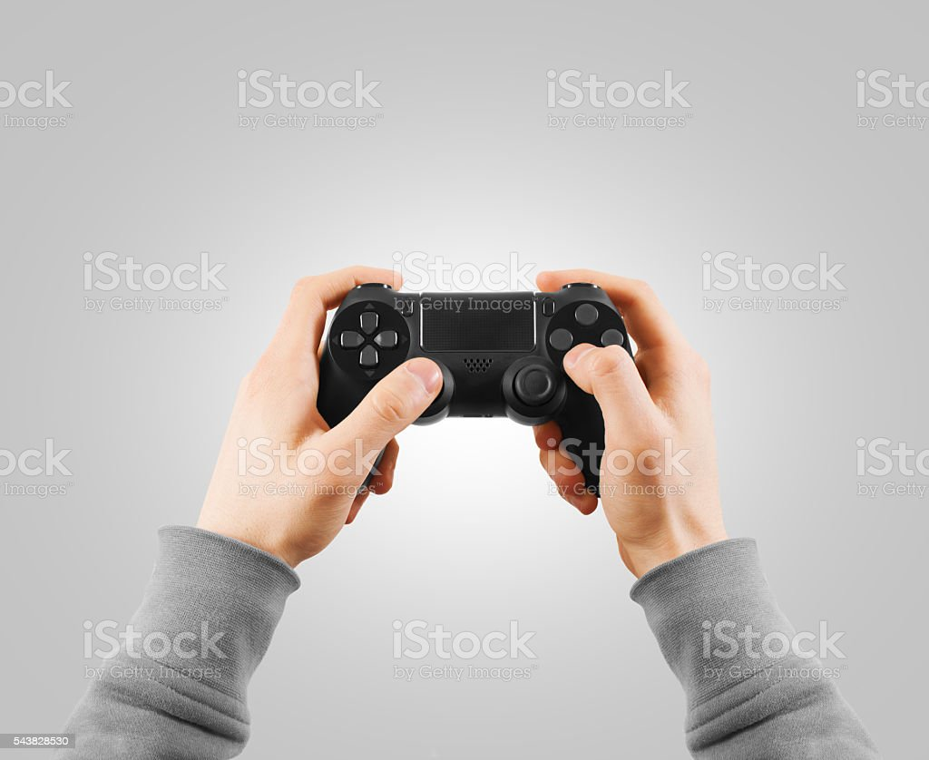 Hand hold new joystick isolated. Gamer play game with gamepad stock photo