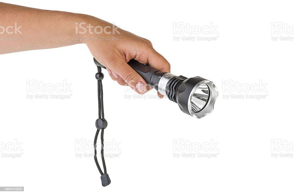 Hand hold powerful LED flashlight stock photo