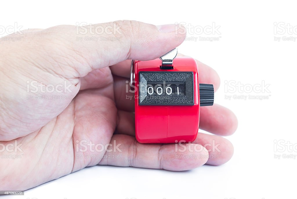 Hand hold red hand tally counter on white background stock photo
