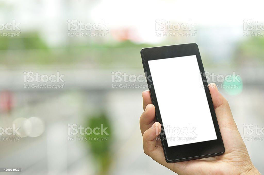 hand hold smart phone at city stock photo