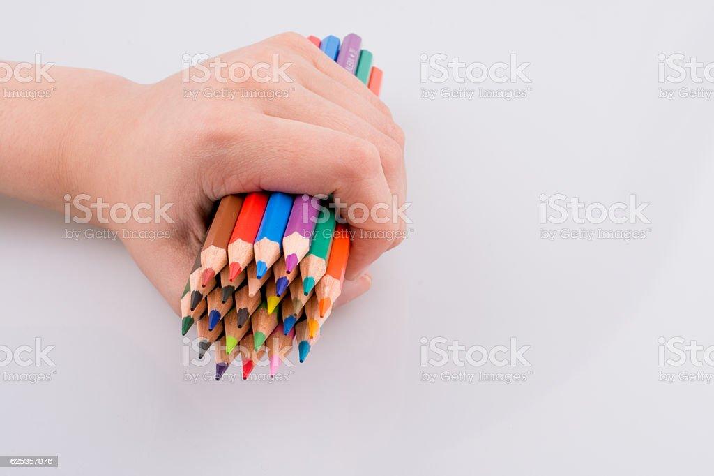 Hand holdin pencils stock photo