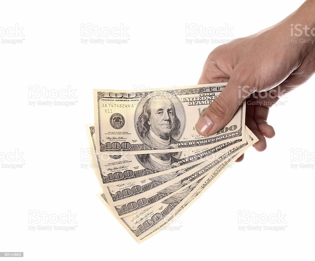 Hand holding $600 over white background isolated. royalty-free stock photo