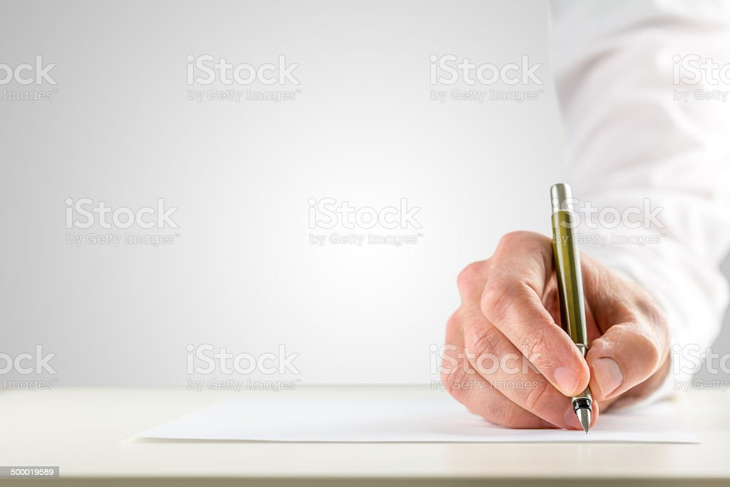 Hand holding a ballpoint in order to start writing stock photo