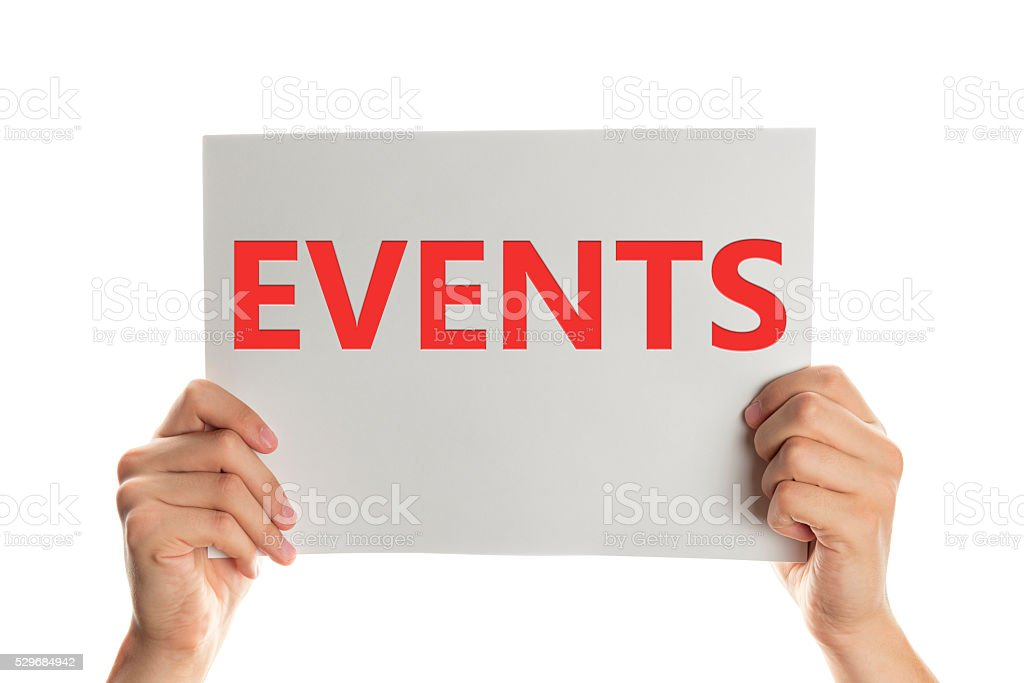 Hand holding a banner with the showing events message. stock photo