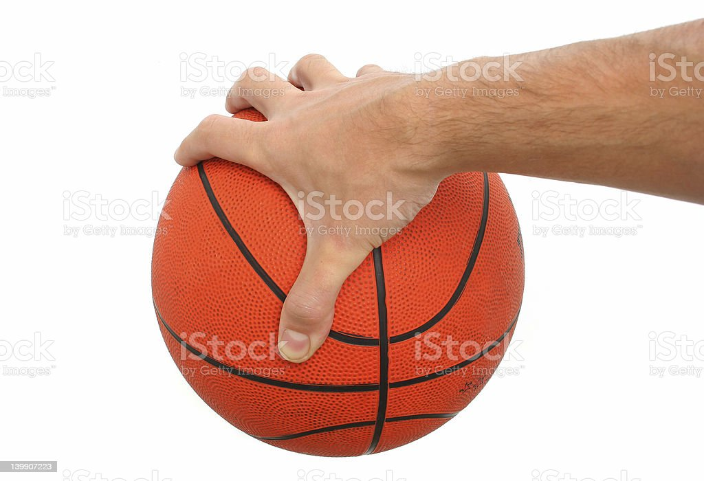 Hand holding a basketball ball isolated royalty-free stock photo