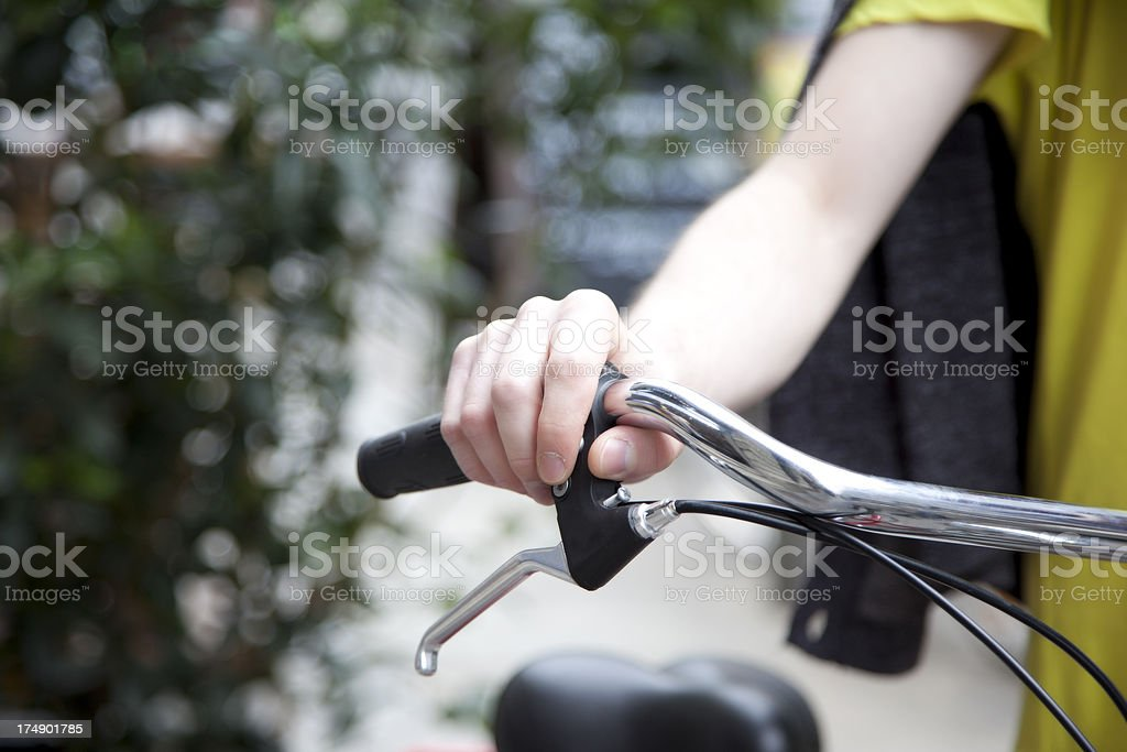 Hand holding a bicycle handwheel stock photo
