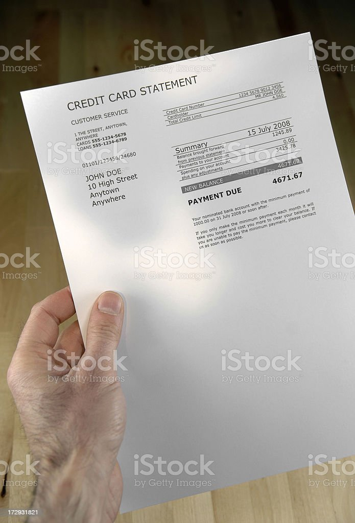 A hand holding a bill on a full size sheet of white paper. royalty-free stock photo