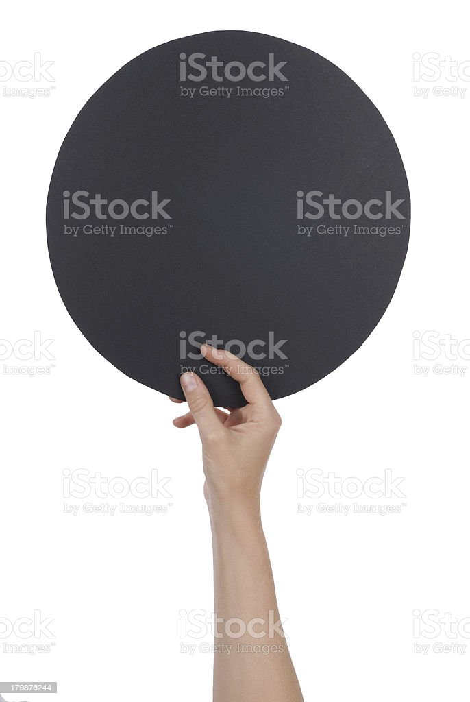 Hand Holding a Black Circle royalty-free stock photo
