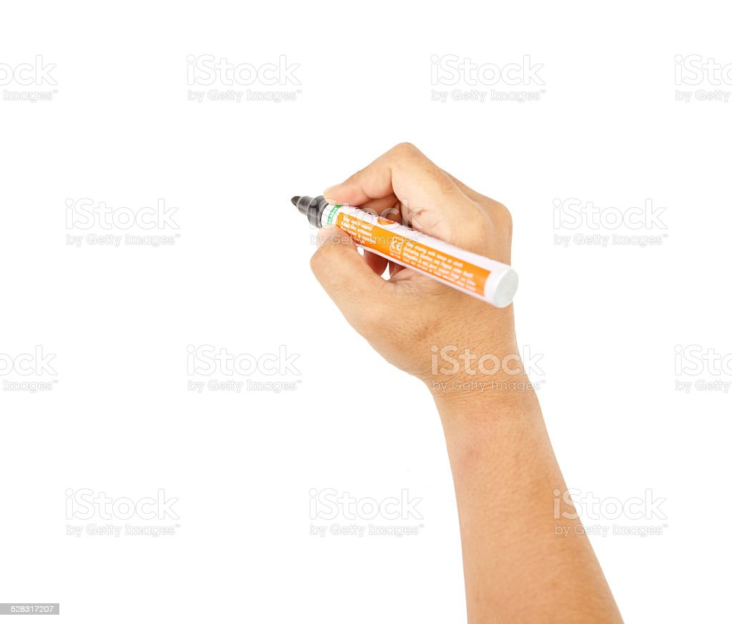 hand holding a black marker, isolated on white background stock photo