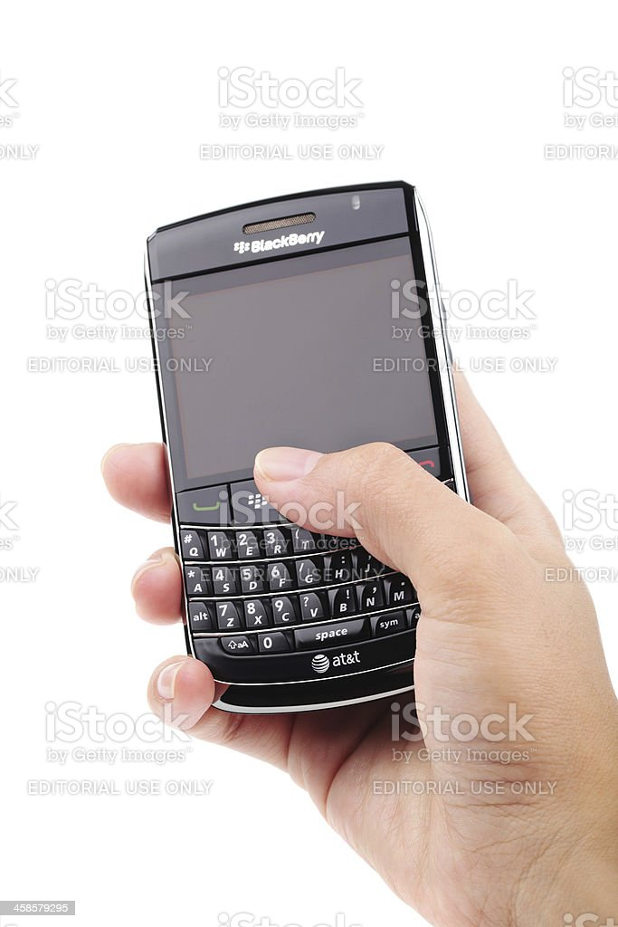 Hand holding a blackberry phone royalty-free stock photo