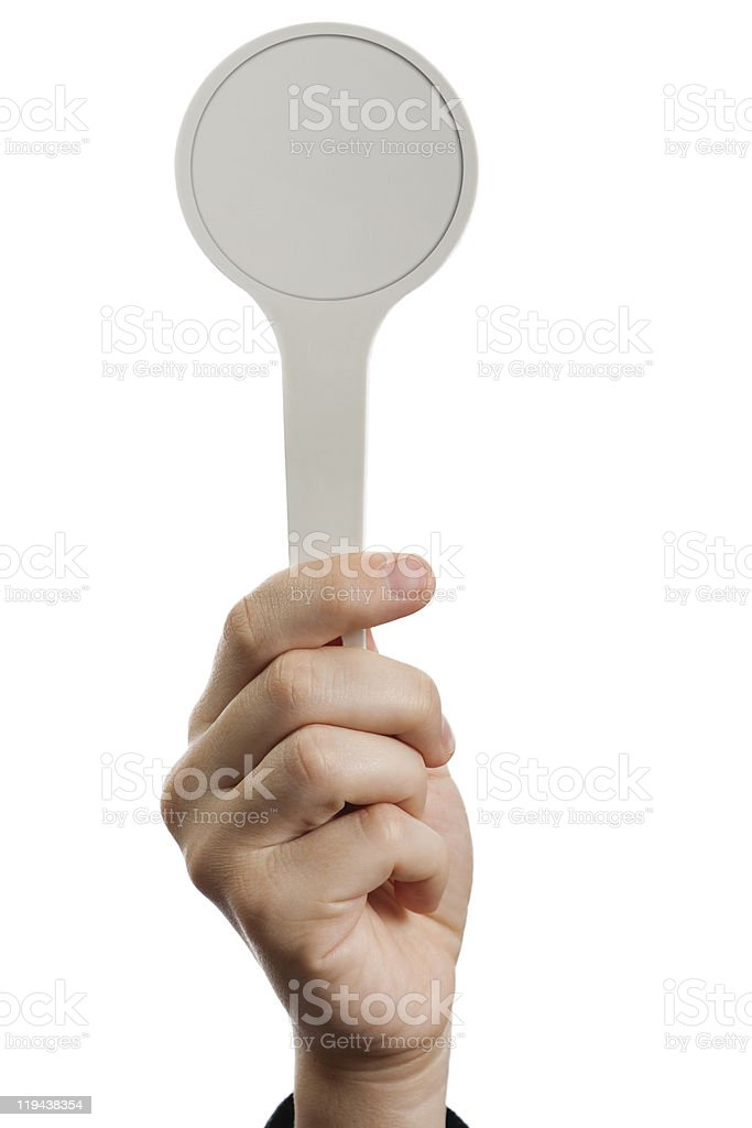 A hand holding a blank auction paddle stock photo