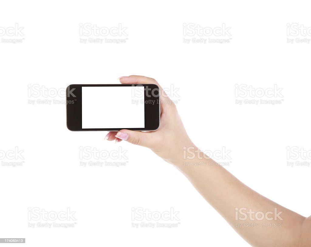 Hand holding a blank mobile phone on a white background royalty-free stock photo