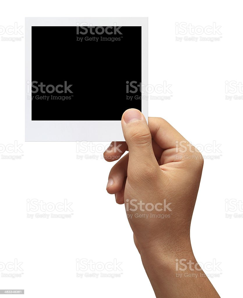 Hand holding a blank photo stock photo