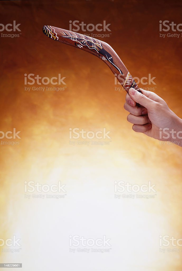 Hand Holding a Boomerang stock photo