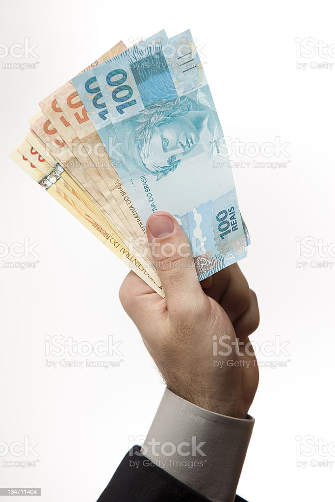 Hand holding a Brazilian money stock photo