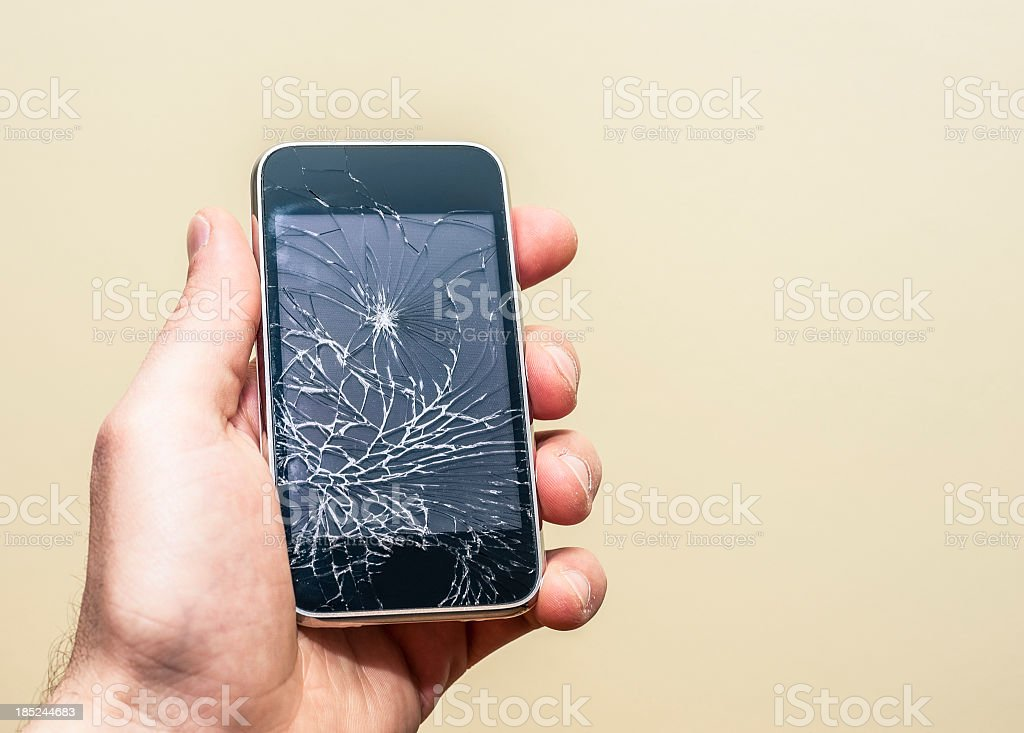 Hand holding a broken smart phone stock photo