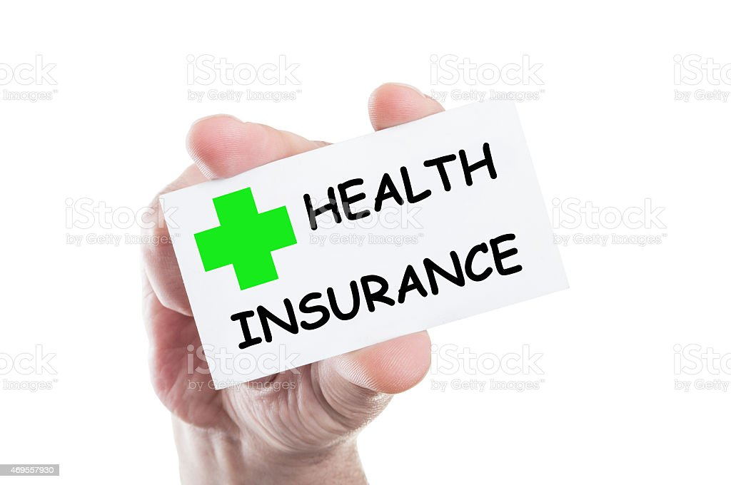 Hand holding a business card reading health insurance  stock photo