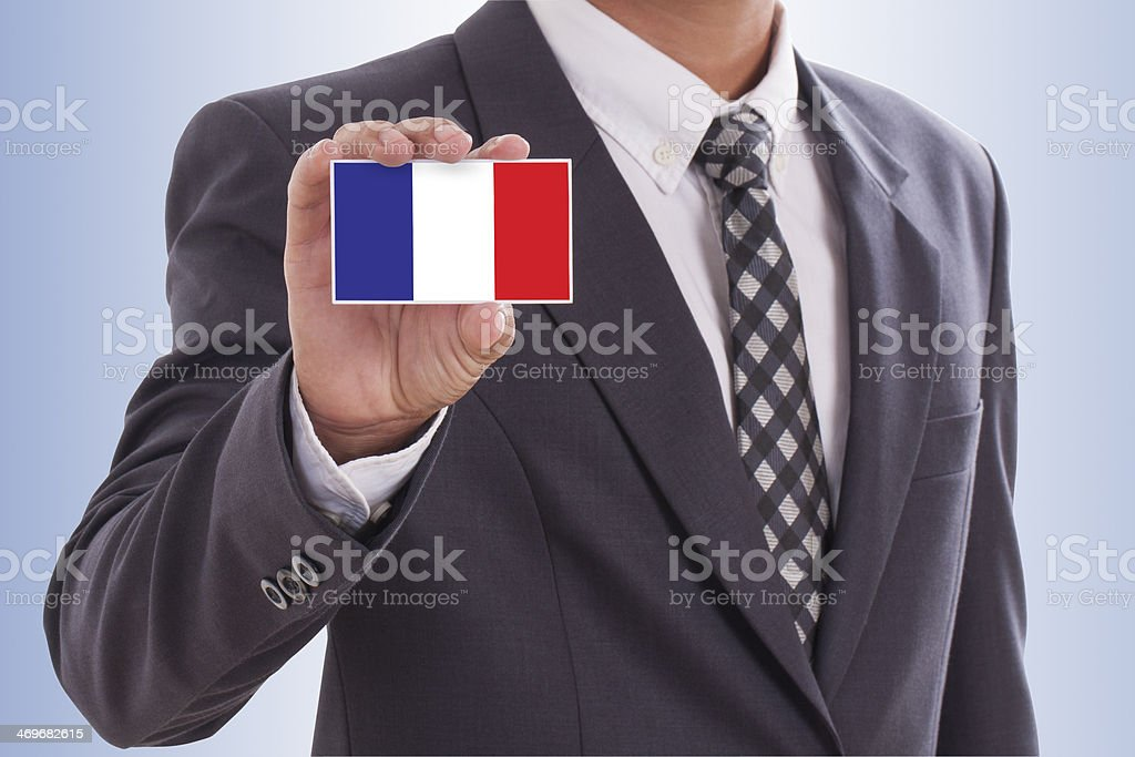 hand holding a business card with French Flag royalty-free stock photo