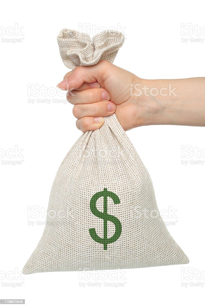 Hand holding a canvas moneybag isolated on white background stock photo