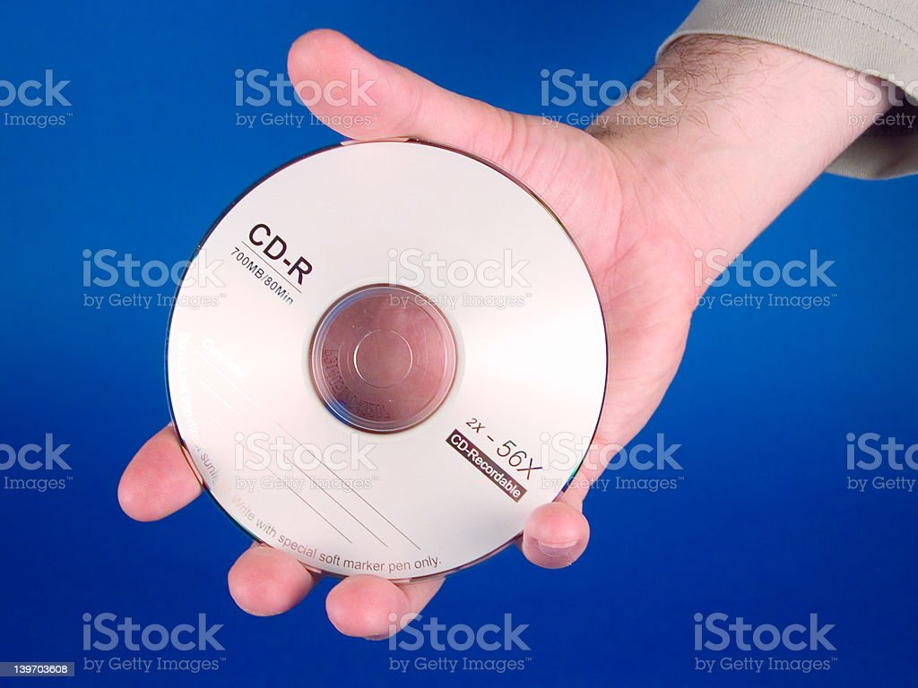 Hand holding a CD royalty-free stock photo