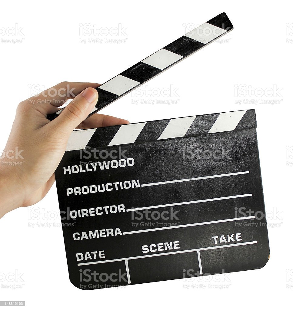 Hand holding a clapper board stock photo