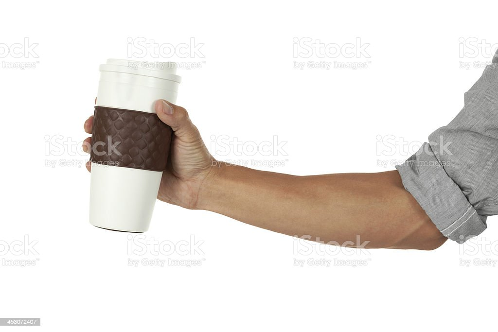 Hand holding a coffee mug stock photo