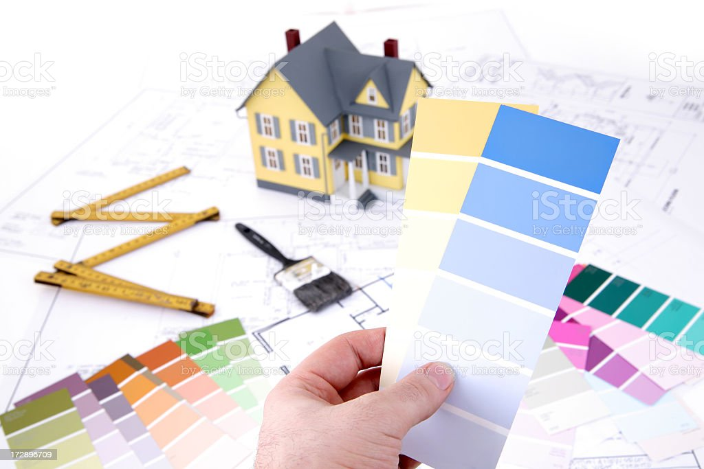 A hand holding a color swatches stock photo