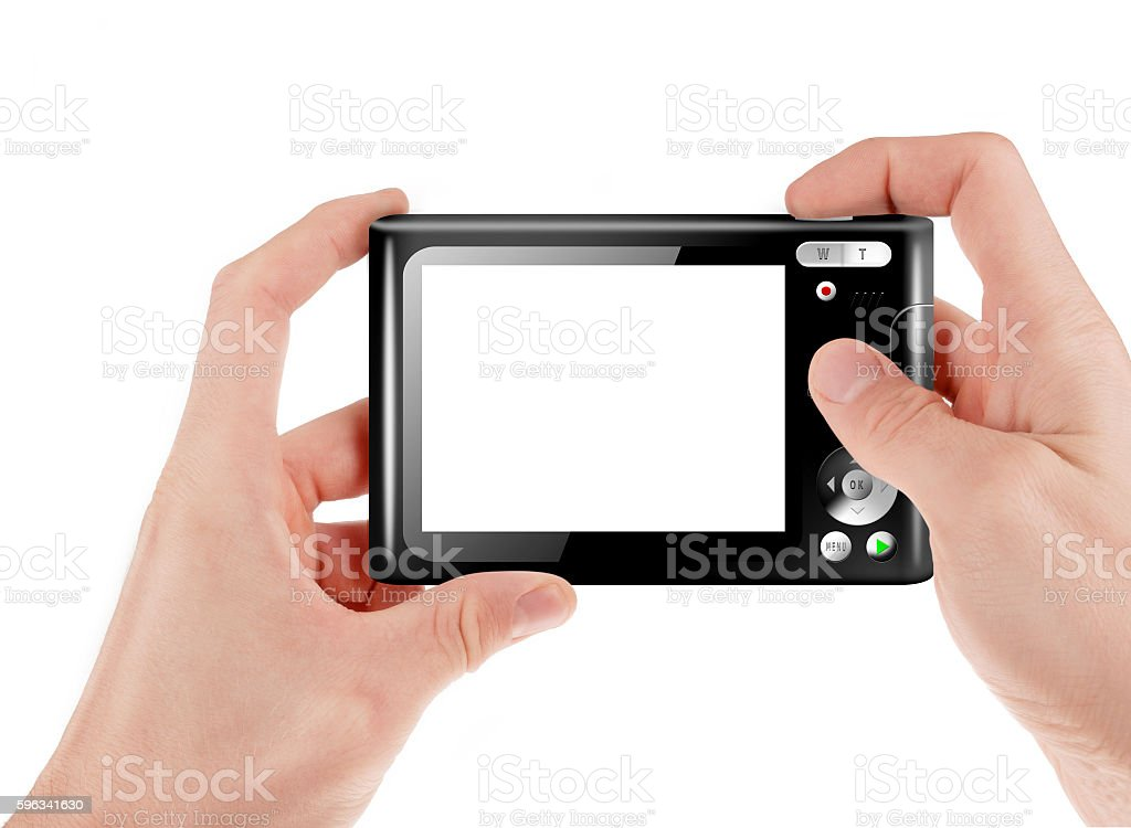 Hand holding a compact digital camera stock photo