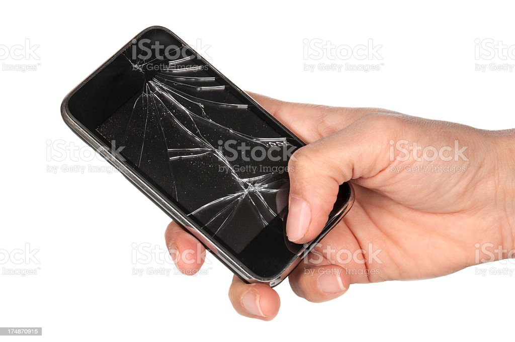 A hand holding a cracked mobile phone royalty-free stock photo