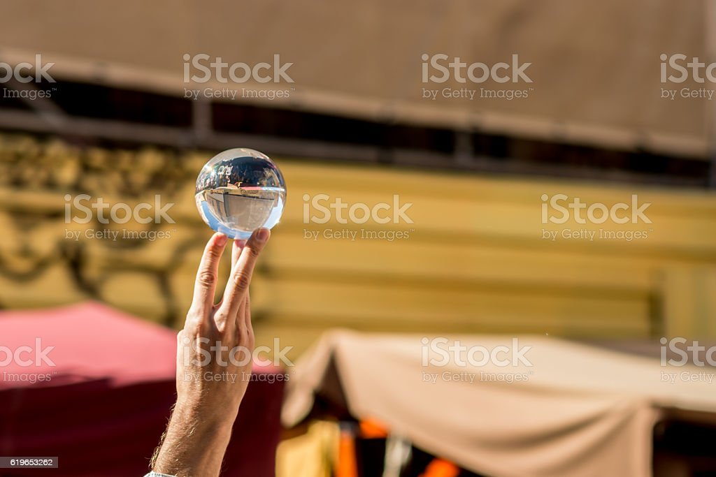 Hand holding a crystal ball stock photo