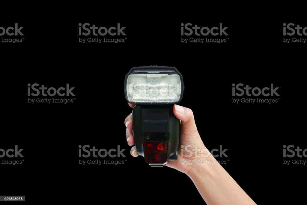 hand holding a flash light isolated on black background. stock photo