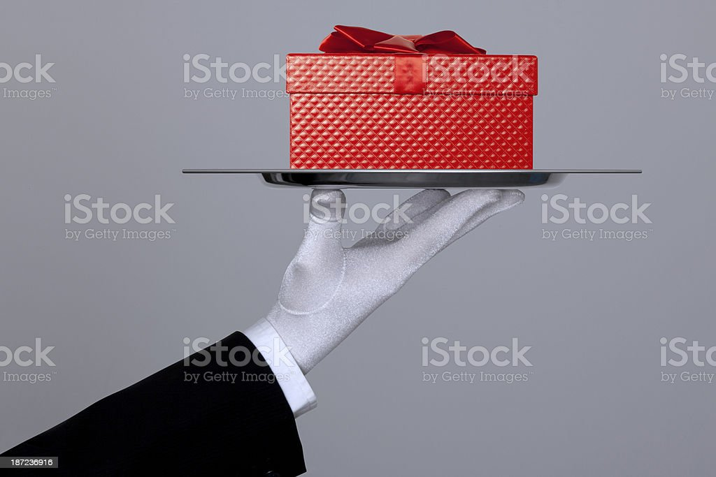 Hand Holding A Gift Box In Tray With Clipping Path stock photo