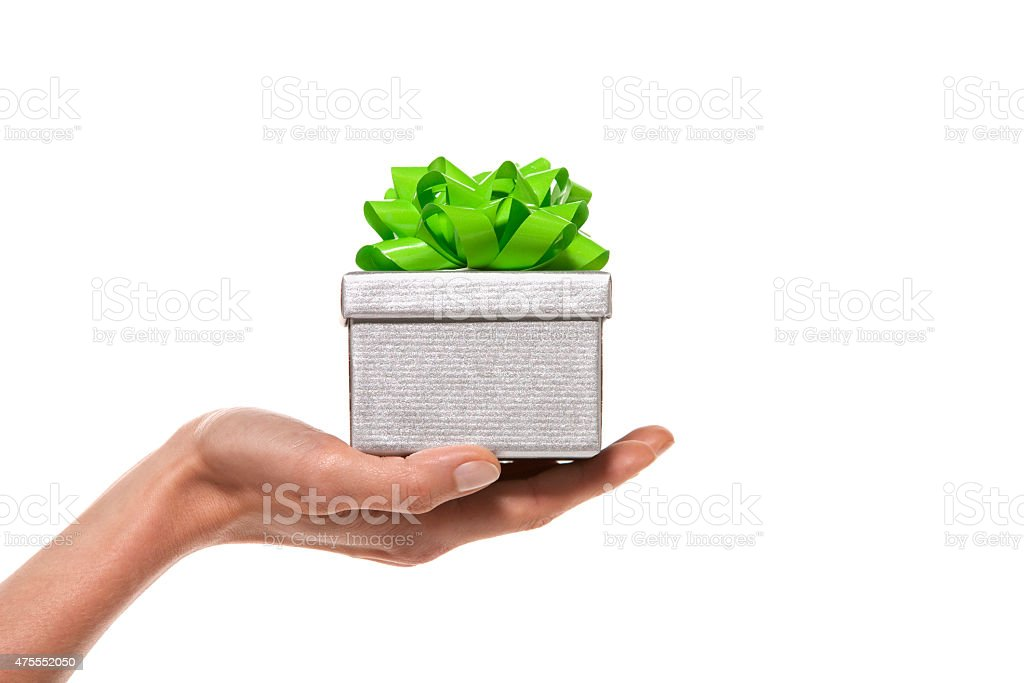 Hand holding a gift box stock photo