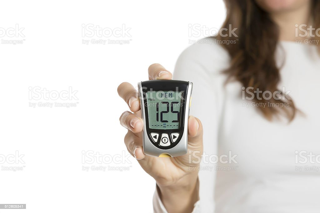 hand holding a glucometer stock photo