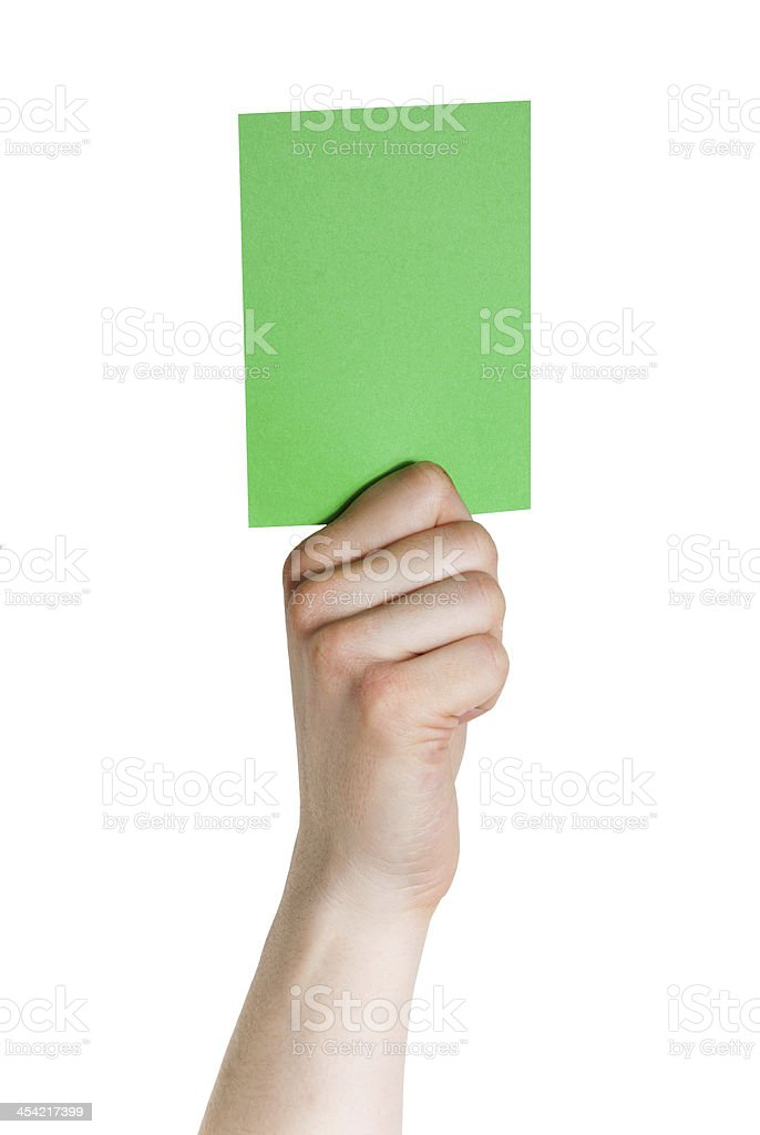 hand holding a green tag royalty-free stock photo