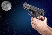 Hand holding a gun isolated on background