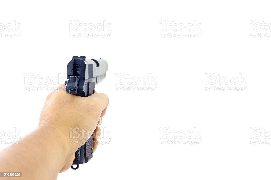 Hand holding a handgun. stock photo