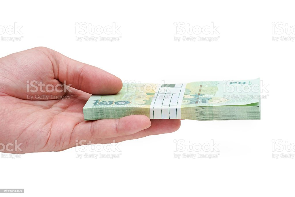 Hand holding a heap of banknote stock photo