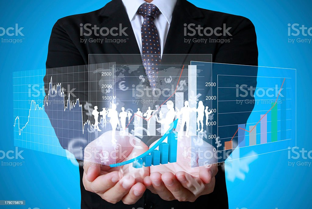 Hand holding a holographic display of financial symbols stock photo