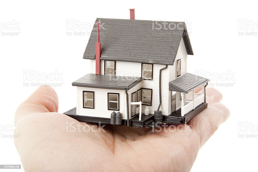 Hand holding a house isolated on white royalty-free stock photo