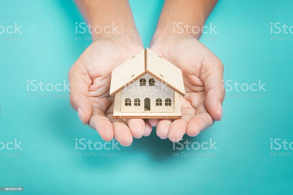 hand holding a house stock photo