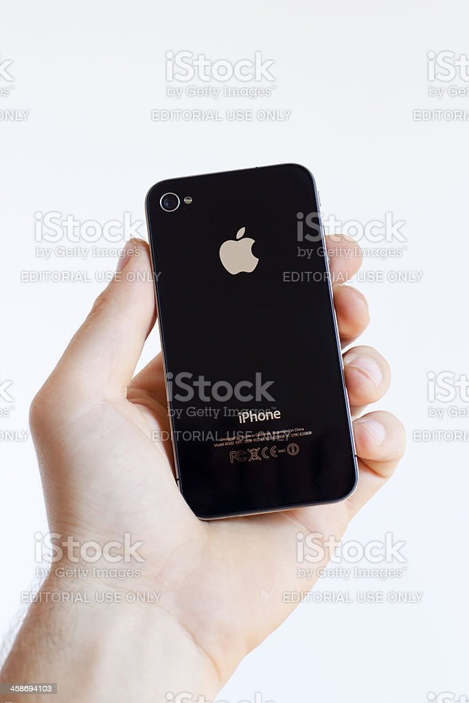 Hand Holding a Iphone 4, Rear View royalty-free stock photo