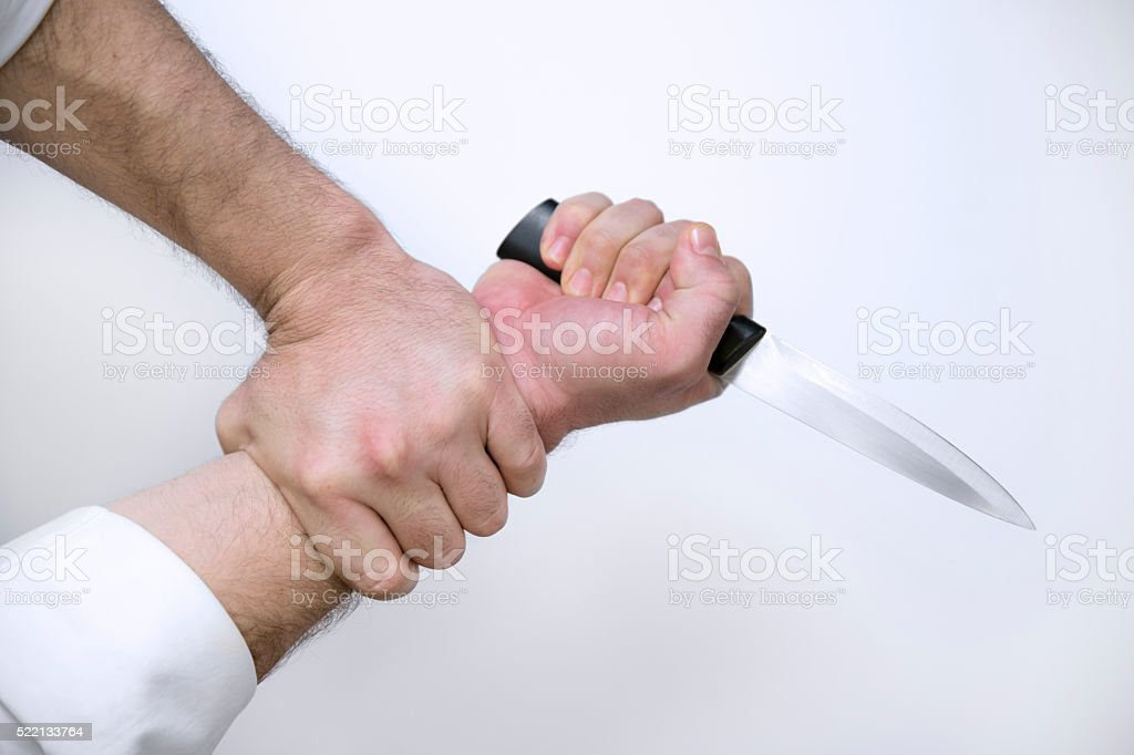Hand Holding A Knife stock photo