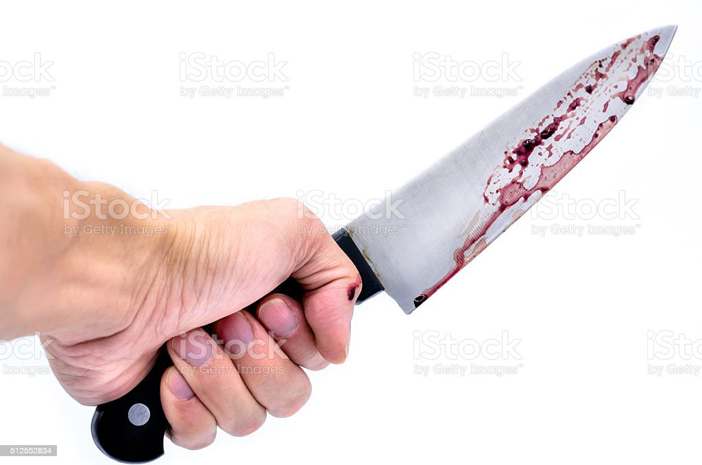 Hand holding a knife with Dripping blood stock photo