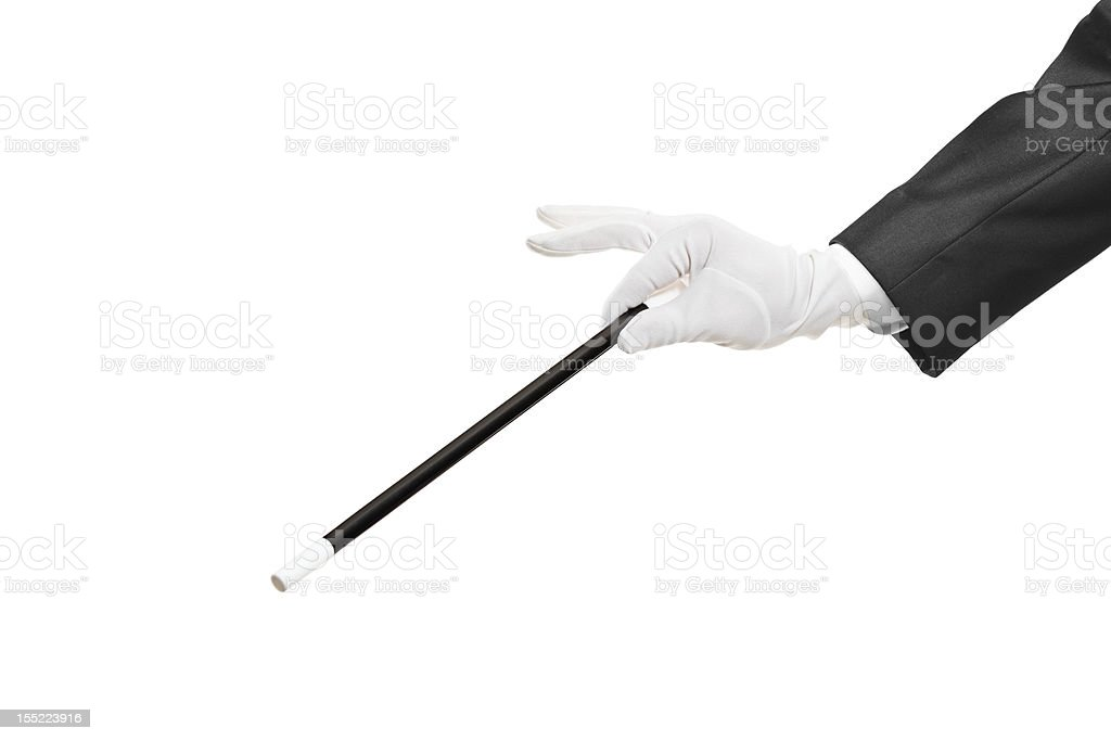 Hand holding a magic wand stock photo