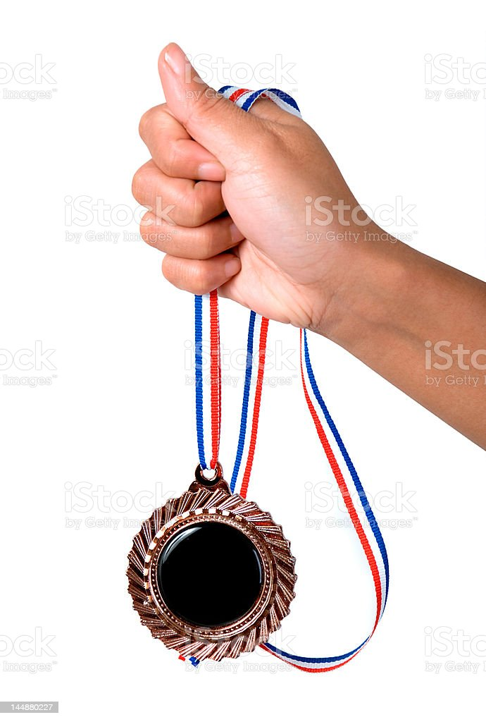 Hand holding a medal royalty-free stock photo