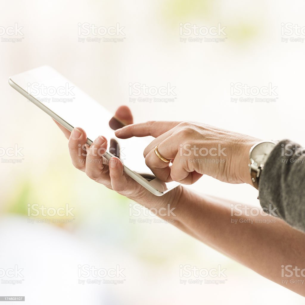 hand holding a mini digital tablet royalty-free stock photo