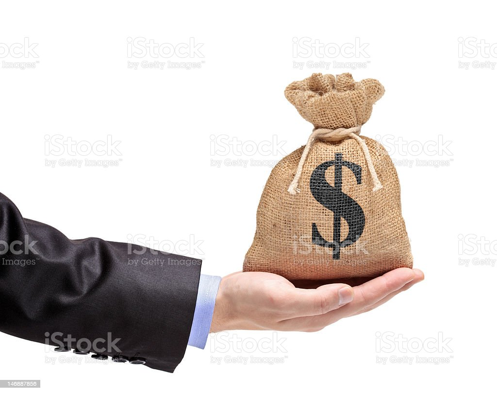 Hand holding a money bag stock photo