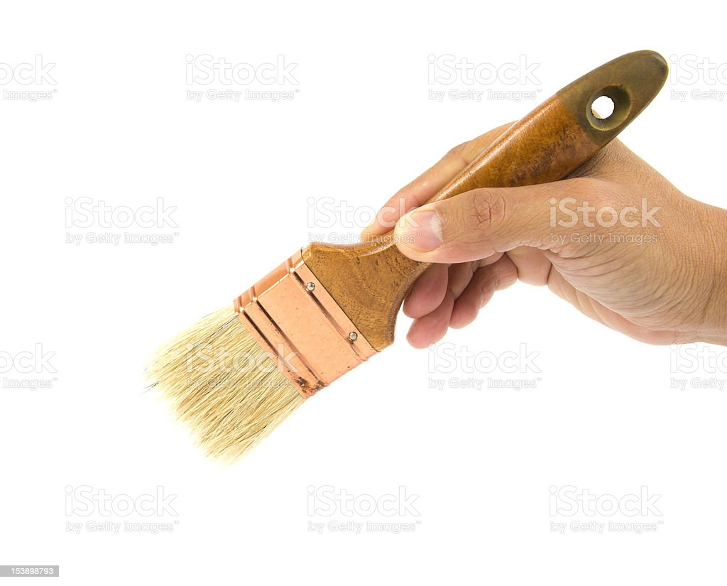 Hand holding a paint brush. royalty-free stock photo
