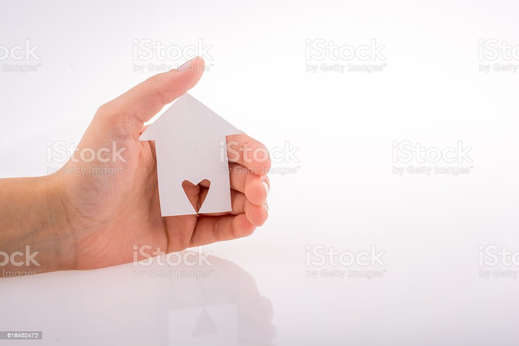 Hand holding a paper house stock photo